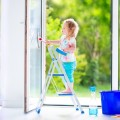 How can you keep small children safe near windows?